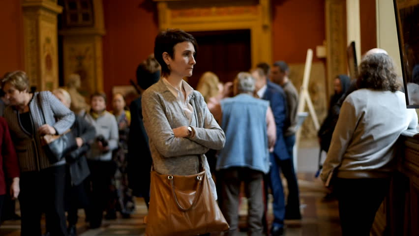 ST. PETERSBURG, RUSSIA - FEBRUARY 25, 2016: People at the exhibition dedicated to architect Maximilian von Messmacher during the celebration of 140th anniversary of Art and Industry Stieglitz Academy | Shutterstock HD Video #15653725