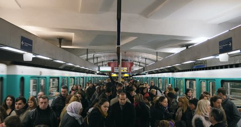 PARIS, FRANCE - FEB 2016: Porte des Versailles Paris metro station with large congestion of people walking to exit the station or to enter the train