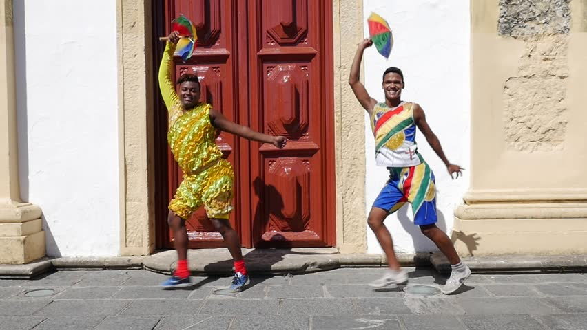 Young Brazilian men dancing Frevo in Olinda, Brazil