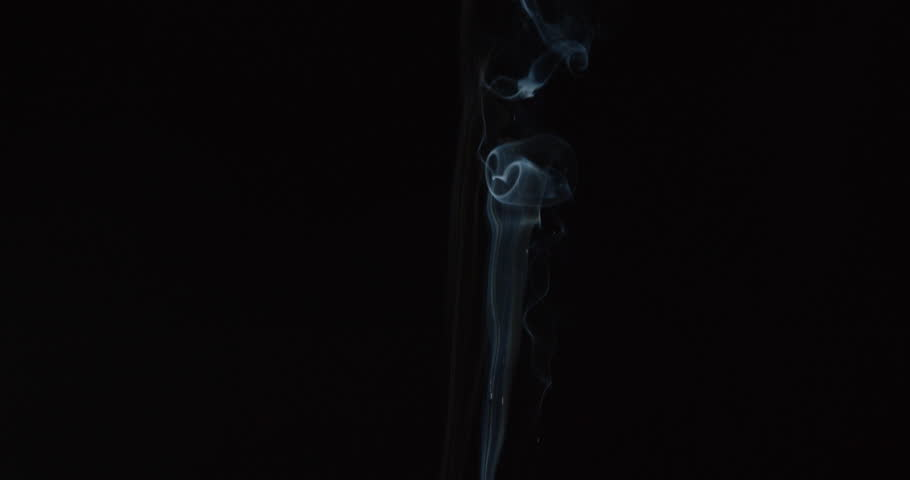 Candle smoke wisps rise in smooth lines and grow turbulent in breeze against black background for compositing, ALPHA MATTE