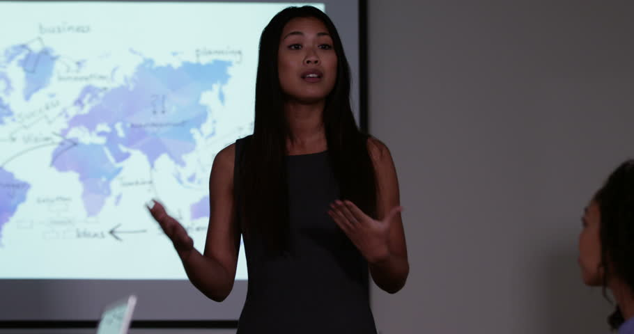 4k, An attractive young Asian female team leader presenting a financial report to his team. Slow motion.