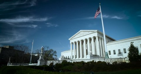 The US Supreme Court wide 4K blue sky high clouds nice flags. Available in 4K and HDR.