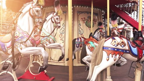4K Traditional Fairground Vintage Carousel in the Park. Merry-go-round with horses. 4K Ultra HD 3840x2160 Video Clip