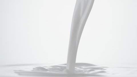 Pouing milk and making splash. Shot with high speed camera, phantom flex 4K. Slow Motion.