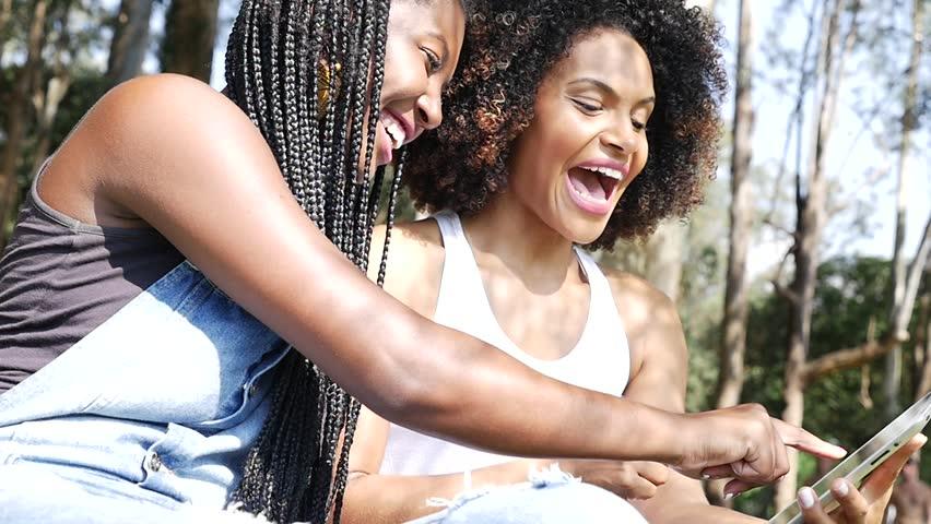 Brazilian afro women using tablet computer in the park, Slow Motion | Shutterstock HD Video #15731737