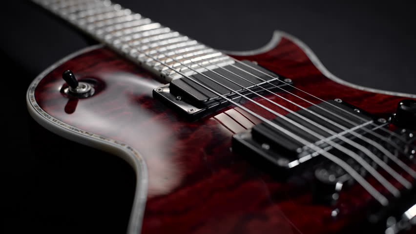 red electro guitar play rock music instrument
