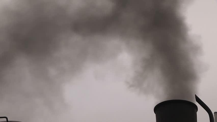 Waterloo, Ontario, Canada October 2014 Waterloo central railway historic steam train blows black smoke and steam