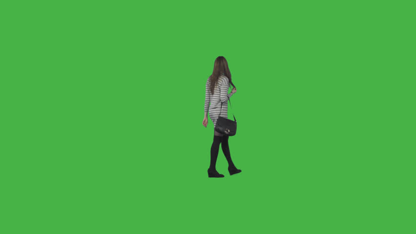 Tall girl in striped mini dress, black long socks & with bag strolls, looks around, views. On transparent background. File format - .mov, codec PNG+Alpha. Shutter angle -180 (native motion blur)