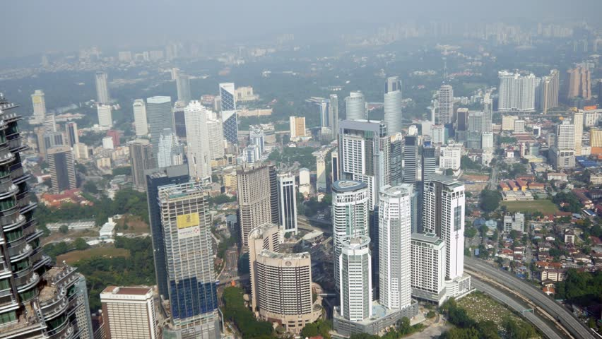 Kuala Lumpur Asia Malaysia over head aerial shot of Skyline Skyscrapers city busy metropolis business centre  fiancial square tall buildings cityscape modern new technology center | Shutterstock HD Video #15793849