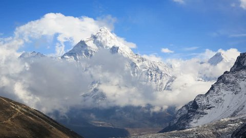 Time lapse of clouds moving around the Ama Dablam (6856m) peak near the village of Dingboche in the Khumbu area of Nepal, on the hiking trail leading to the Everest base camp.