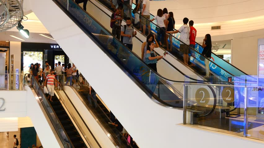 people on escalators. bangkok, thailand / august 15th 2015: escalator 4k shopping mall crowd of people buy shop center centre time lapse timelapse full multiple on escalators