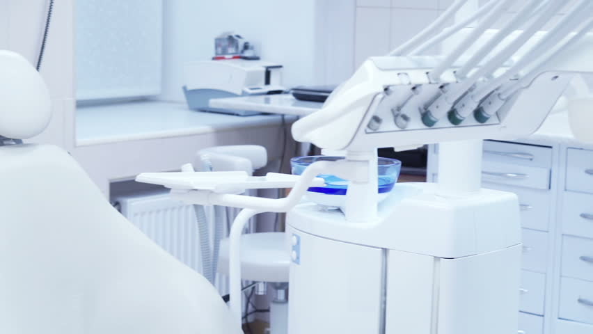 Dental clinic: room with dental chair and medical equipment #15879940