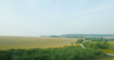 View from the high speed train TGV at beautiful French landscapes