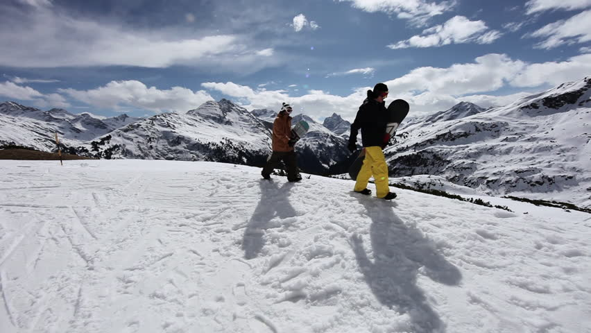 November 16, 2010: Two men carrying snowboards in ski resort | Shutterstock HD Video #15897067