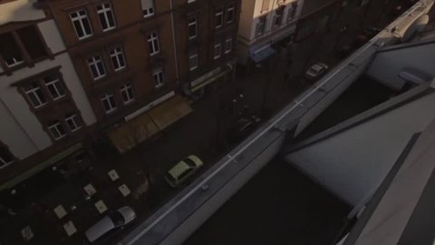 Parkour Runner does long run over rooftaop in frankfurt germany.