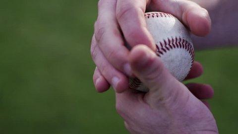 Slow motion close-up shot hands rubbing up baseball