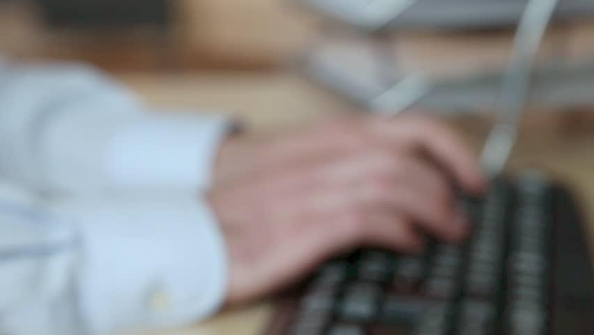 December 04, 2010: Office worker using computer | Shutterstock HD Video #15975871
