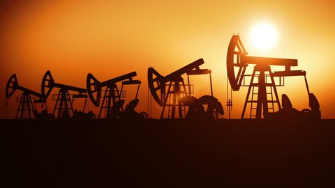 Oil Pumps in a Row at Sunset. Looped 3d animation. Technology and Industrial Concept. HD 1080.