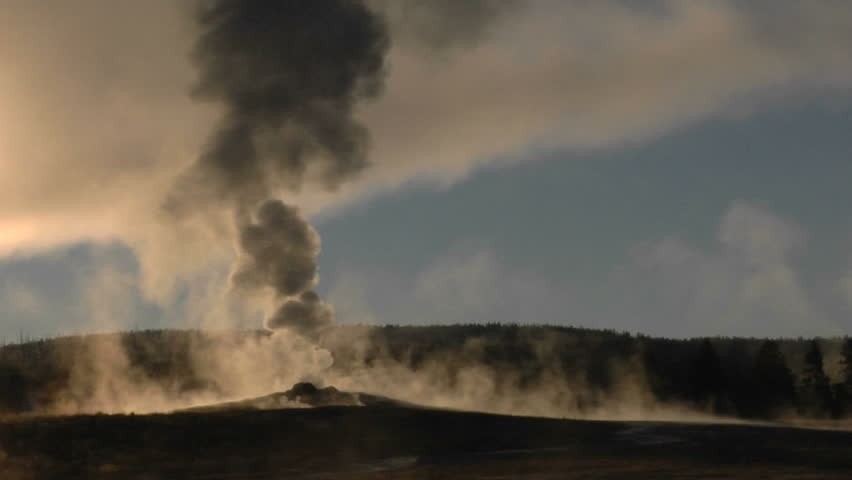 Steam billows out of Old Faithful at Yellowstone National Park