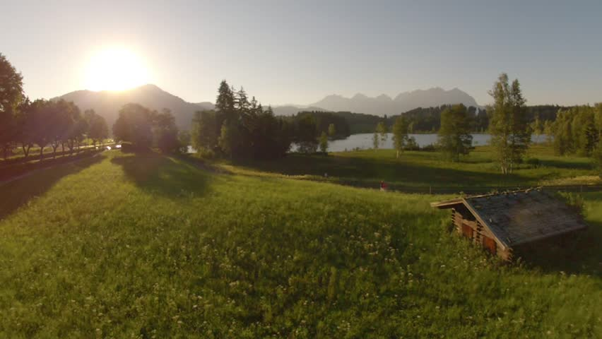 Wooden hut in a beautiful austrian countryside - idyllic summer day #16018759