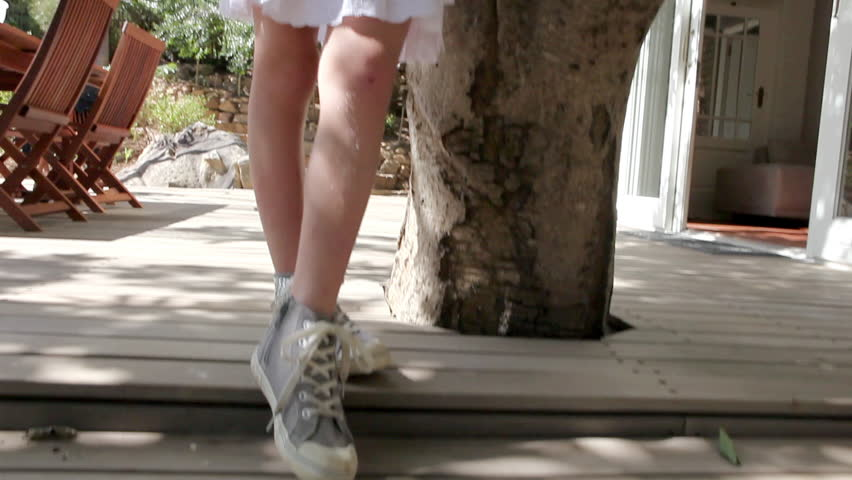 April 03, 2011: Brother and sister climbing tree | Shutterstock HD Video #16024513