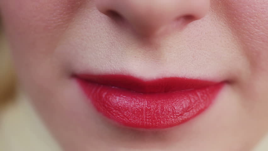Closeup view of female mouth chewing gum. Woman with red lips and bad manners. Fresh breath effect, health care, dental hygiene, advertising. Teeth disease, sweet peppermint product reducing plaque