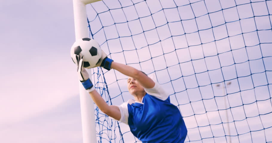 Goalkeeper in blue making a save in slow motion