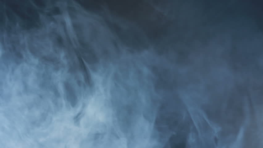 Smoke abstract. Smoke cloud. Smoke on black background in blue light. Smoke effect. Studio shot. Smoke machine. Fog background. Cigarette smoke