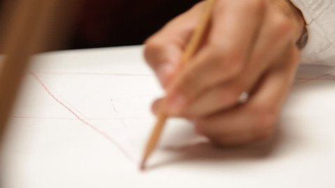 Man draws a pyramid