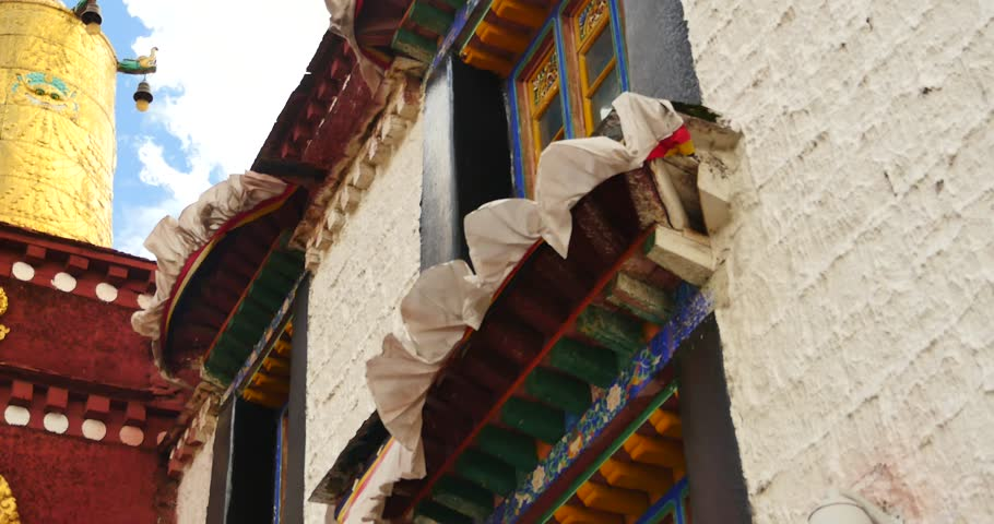 4k closeup of The Jokhang Temple In Lhasa,Tibet,white clouds in blue sky. gh2_09675_4k