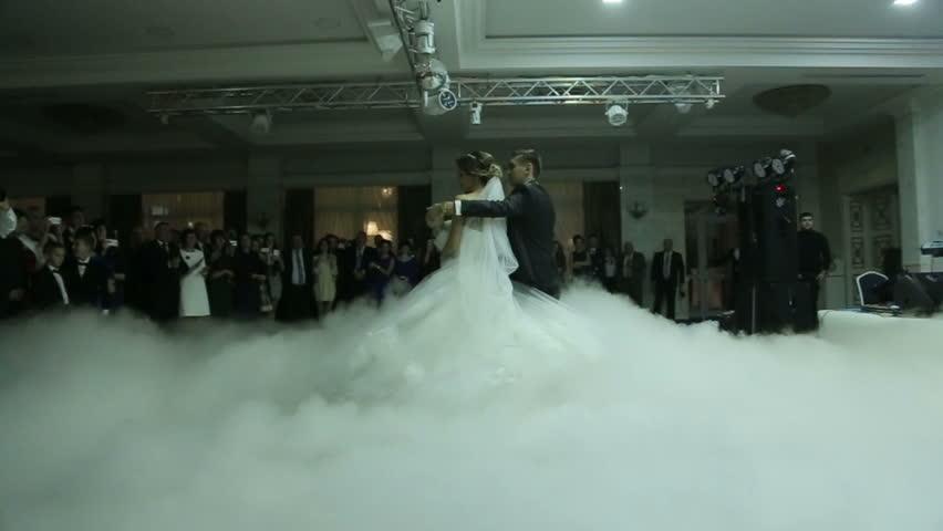 Happy Newlyweds Dancing Waltz Shrouded By White Fume Wonderful Wedding Party