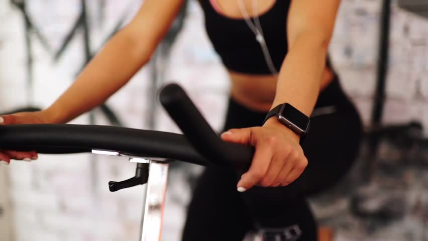Smart watch showing a heart rate of exercising woman in gym | Shutterstock HD Video #16079623