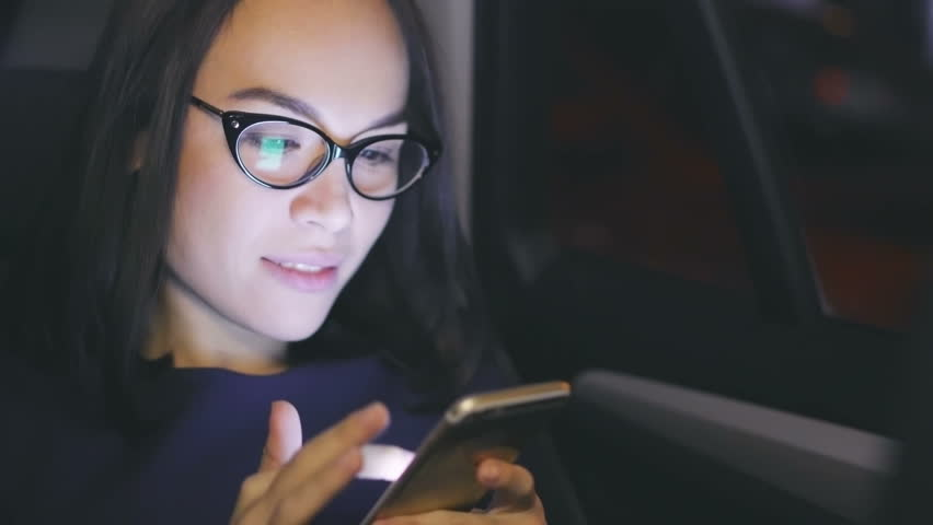 Close up of Asian businesswoman in the car making a phone call