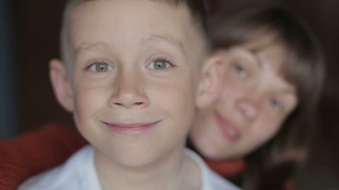 A child with his mother makes selfie
