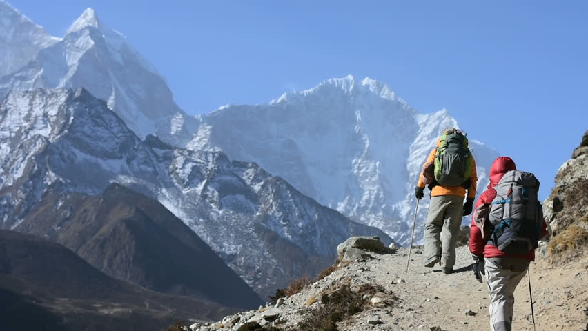 Trekkers hiking at High Himalaya mountain