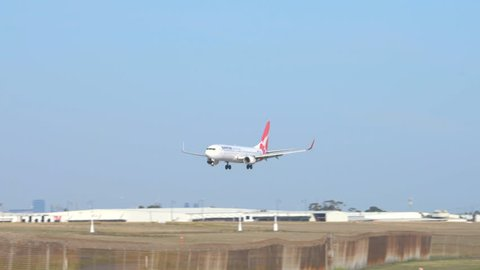 Melbourne, Australia - Apr 26, 2016: 4k video of a Qantas passenger airplane landing at Melbourne Airport