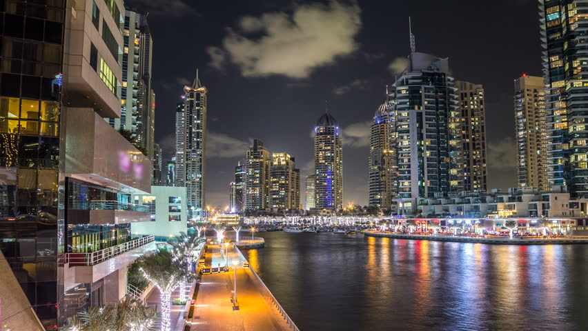 View of Dubai Marina Towers and canal in Dubai night timelapse hyperlapse