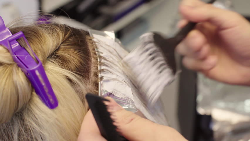 Hairdresser Dye The Hair, He Separates The Strands Of Hair Comb ...