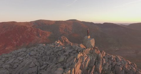 Dawn on Tryfan - Aerial shot of female on a mountain summit