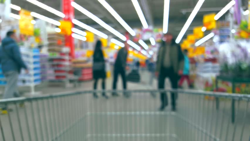 Defocused blurred background supermarket interior with buyers with trolley | Shutterstock HD Video #16272169