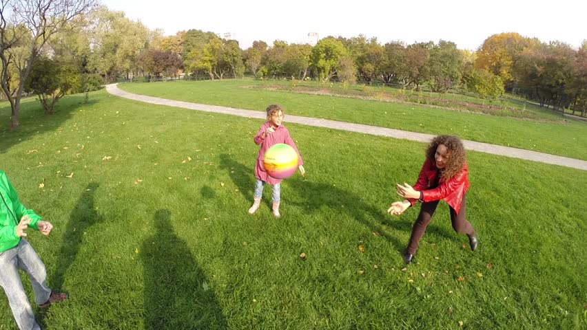 Happy mother, son, daughter play ball in autumn park, First Person View | Shutterstock HD Video #16305889