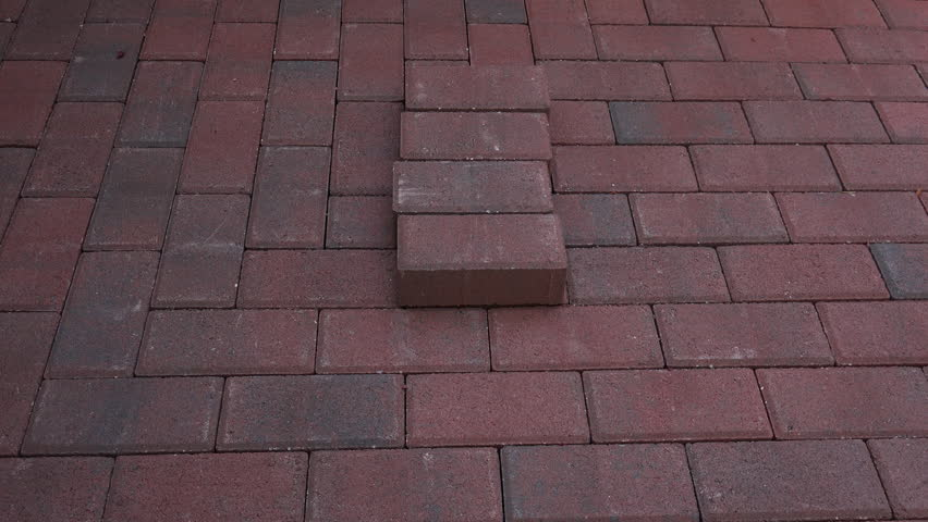 Time Lapse, Worker wears gloves, stacks clay pavers into horizontal, then vertically rows on already laid brick background. 4K UHD 3840x2160  | Shutterstock HD Video #16319896