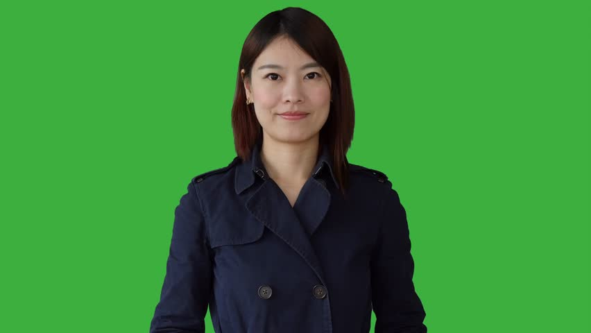 Young asian women standing isolated against green screen background. portrait of chinese  female person.