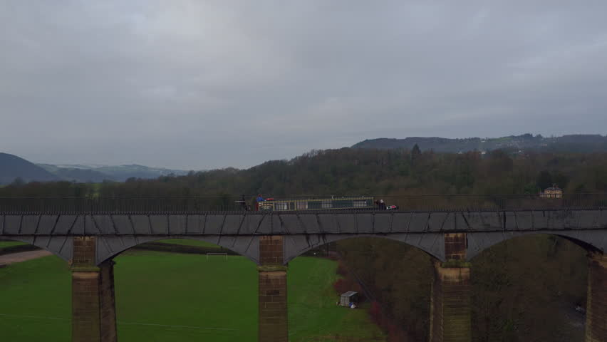 AERIAL: Pontcysyllte Aqueduct - Tracking a barge as it crosses the aqueduct.  - 4K stock footage clip