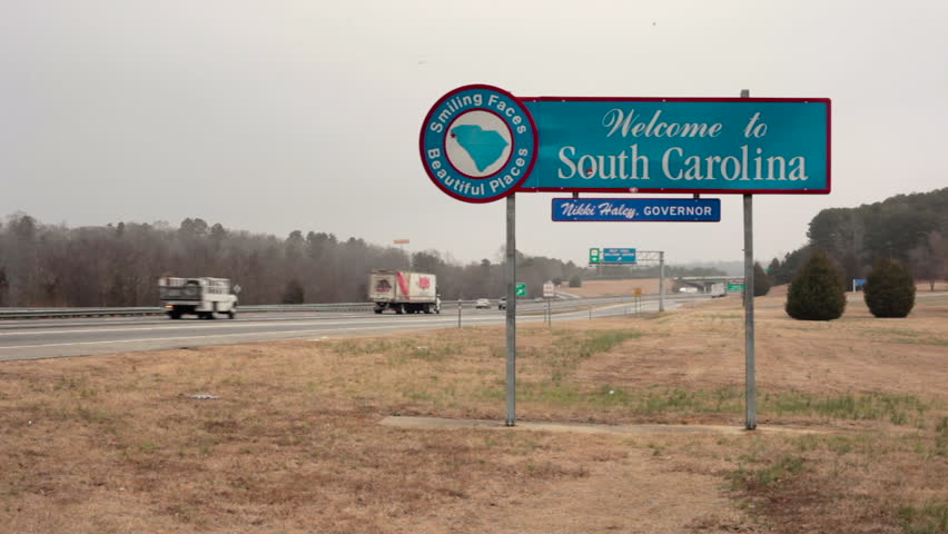 SOUTH CAROLINA, USA - 2 FEB 2014: View of South Carolina welcome sign in the road with vehicles moving