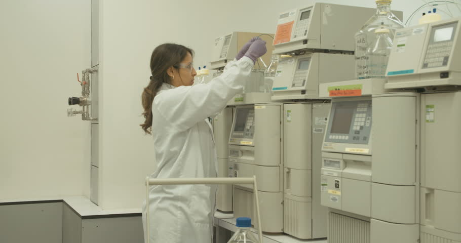 Researcher working with mass spectrometers in a pharmaceutical research lab #16417699