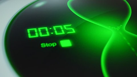 The count down timer for 5 seconds. Digital timer counting down 5 to 0. Green electronic timer with hourglass. Digital stopwatch, count down clock, full hd video background for intro.