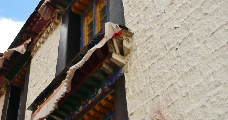 4k closeup of The Jokhang Temple In Lhasa,Tibet,white clouds in blue sky. gh2_09672_4k