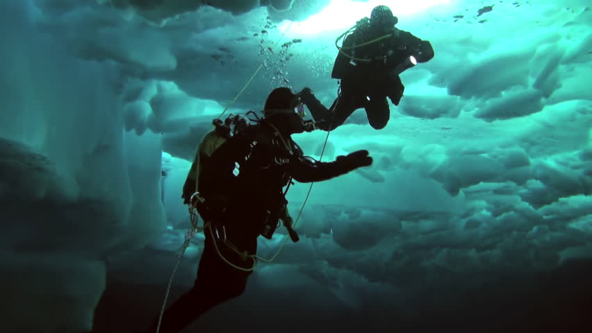 Unique extreme underwater shooting scuba dive beneath ice at geographic  North Pole in cold waters. Fantastic views of the lump of ice in water. ICE CAMP BARNEO, NORTH POLE, ARCTIC - APRIL 10, 2015 | Shutterstock HD Video #16524409