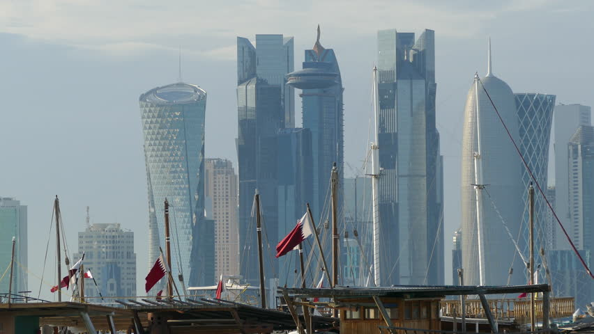 Traditional Dhow, Arab sailing vessels with Qatar flags in the Dhow Harbour with the Doha skyline in the background